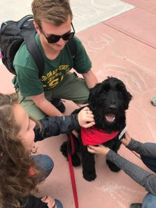 CSU students petting Timber